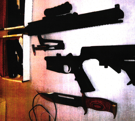 A photo taken during a search of Joseph Brodie's home shows some of the weapons found there.