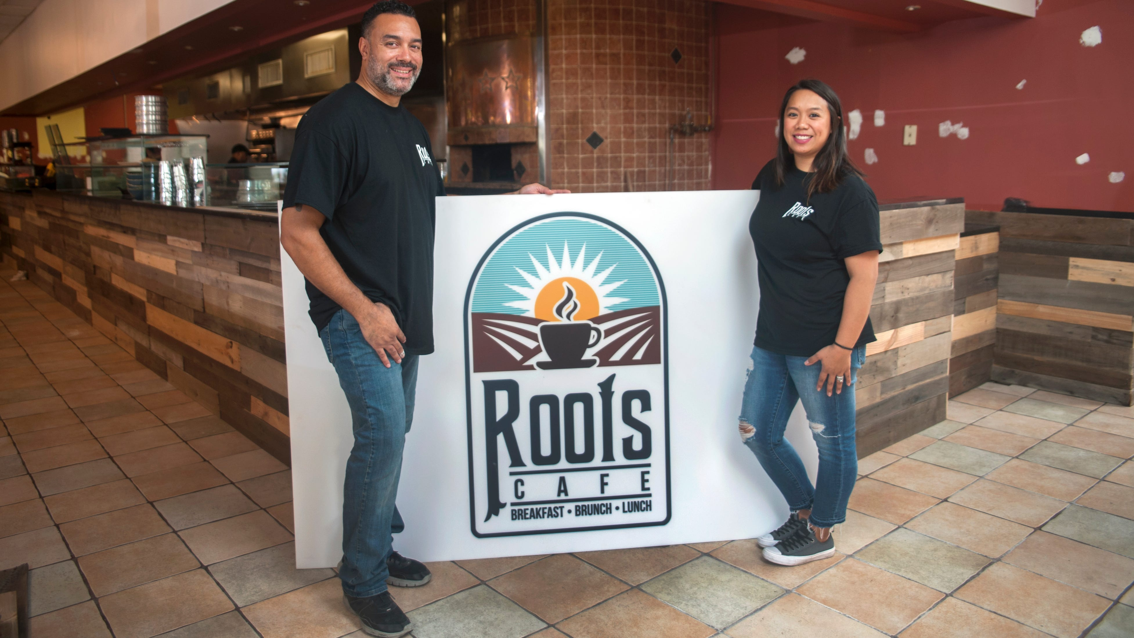 Kevin and Rachelle Johnson, owners of Roots Cafe, stand in their restaurant that is located at the site of the former Forno in Maple Shade.  The restaurant is undergoing finishing touch renovations, and is expected to have its soft opening the week of Oct. 15.