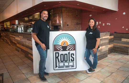 Kevin and Rachelle Johnson, owners of Roots Cafe, stand in their restaurant just before its opening in October 2018. Now the restaurateurs have closed and plan to reopen in another location.