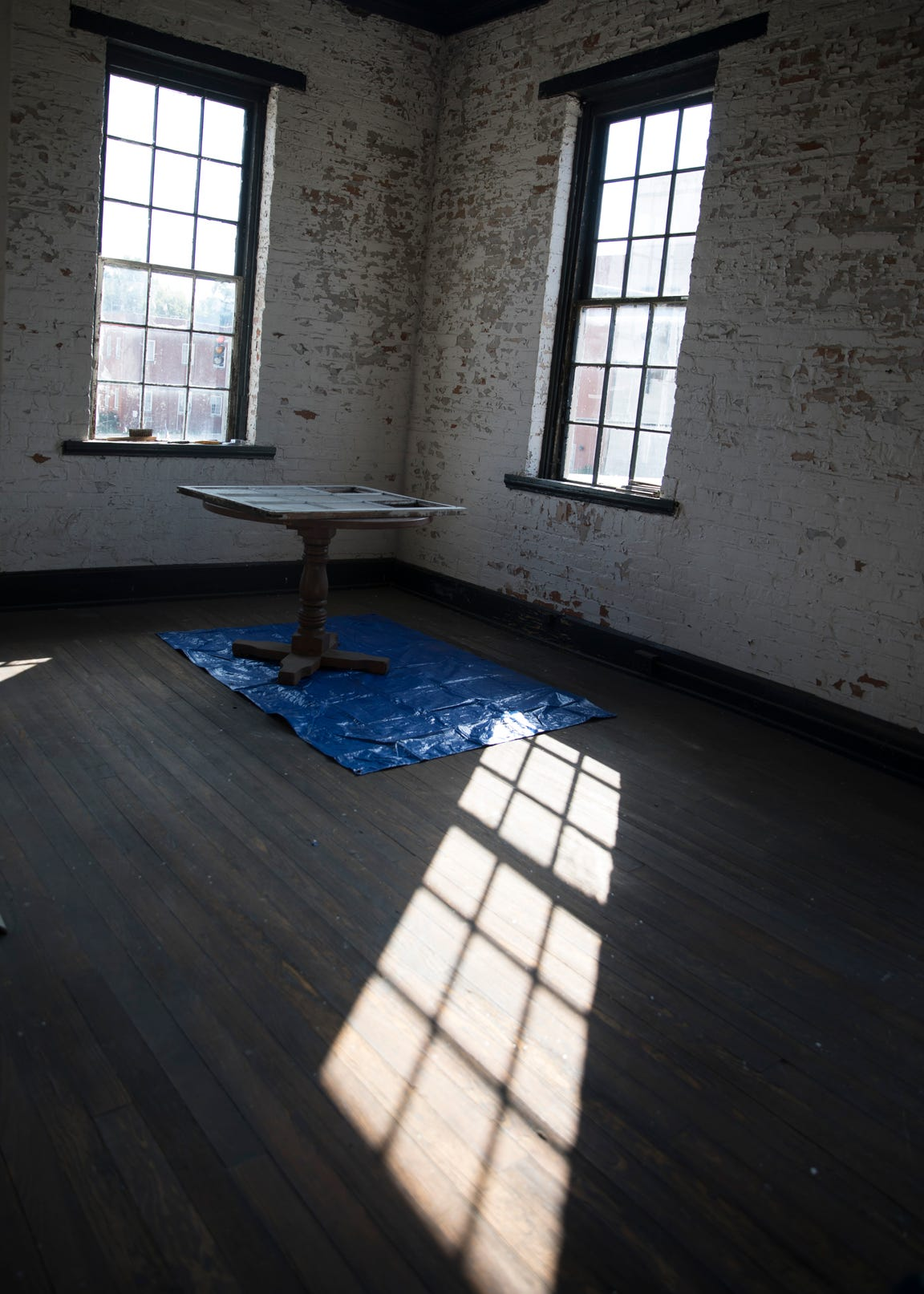 Sunlight streams through the windows into the second floor corner of the old canal warehouse directly above the first floor corner which was badly damaged in a 2017 crash.