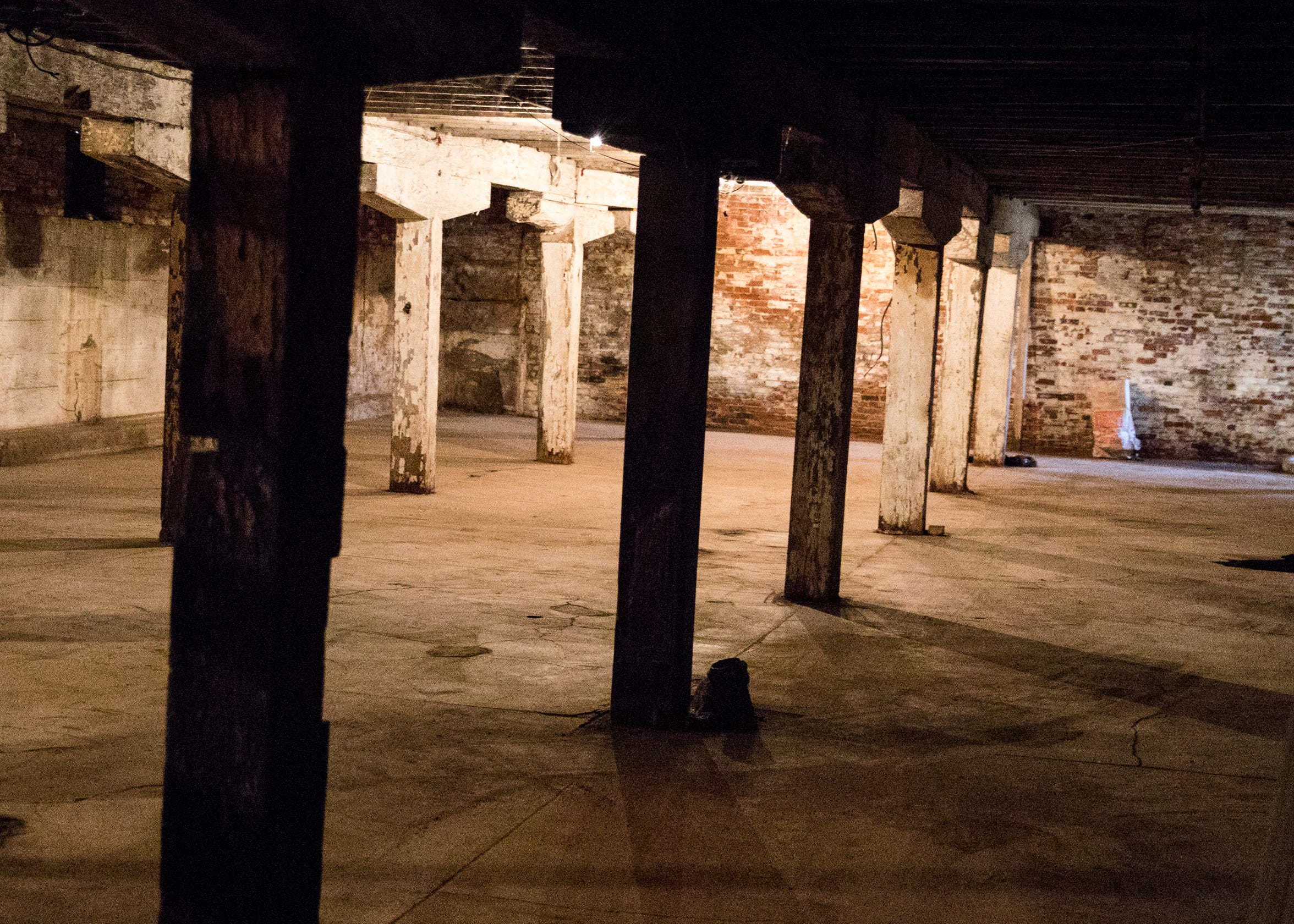 The old canal warehouse supports include several large oak columns, beams, and joists.