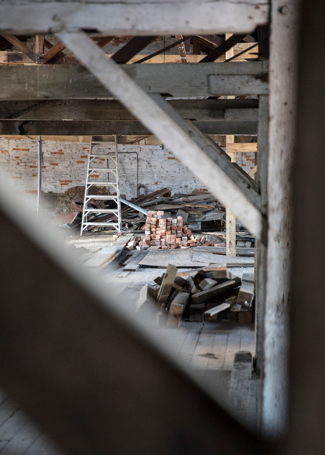 Bricks on the third floor of the old canal warehouse will be used in the restoration of the building corner that was damaged in a 2017 traffic crash.