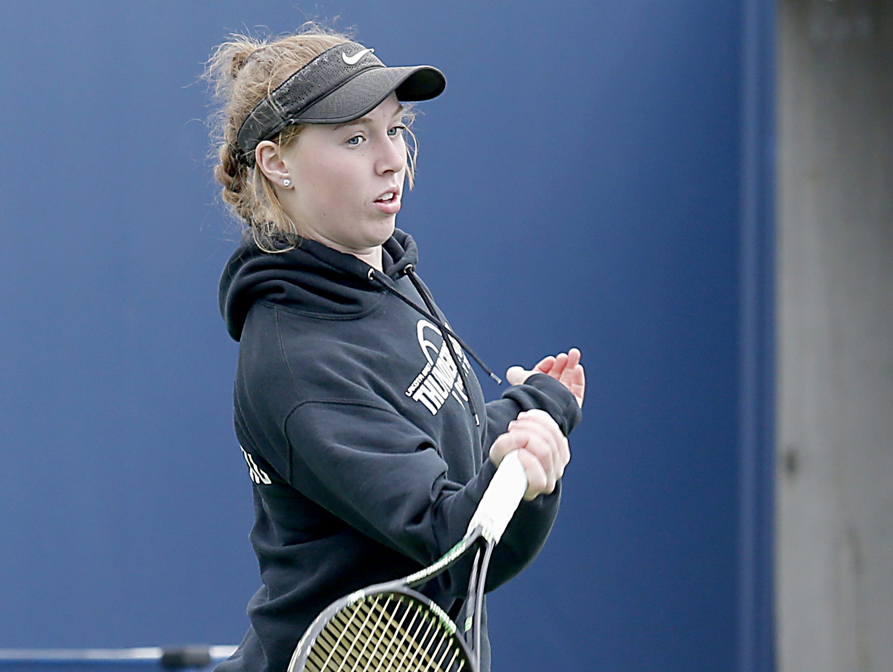 Lakota East's Grace Silverberg warms up for the girls district tennis tournament Division I doubles bracket at the Lindner Family Tennis Center in Mason Thursday, Oct. 11, 2018.