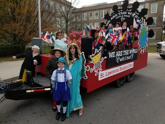 A local student choir from St. Lawrence School participates in the 2017 Price Hill Thanksgiving Day Parade.