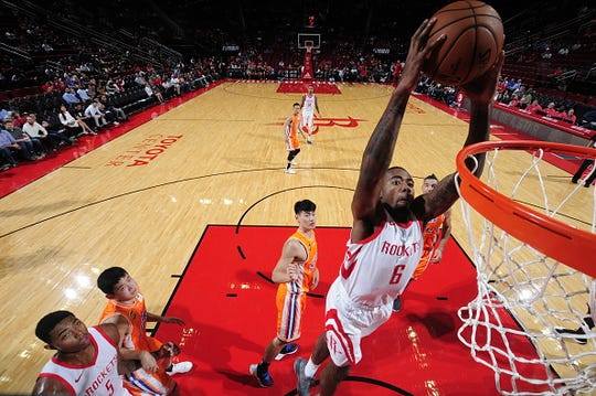 Gary Clark #6 of the Houston Rockets shoots the ball against the Shanghai Sharks during a preseason game on October 9, 2018 at Toyota Center, in Houston, Texas.