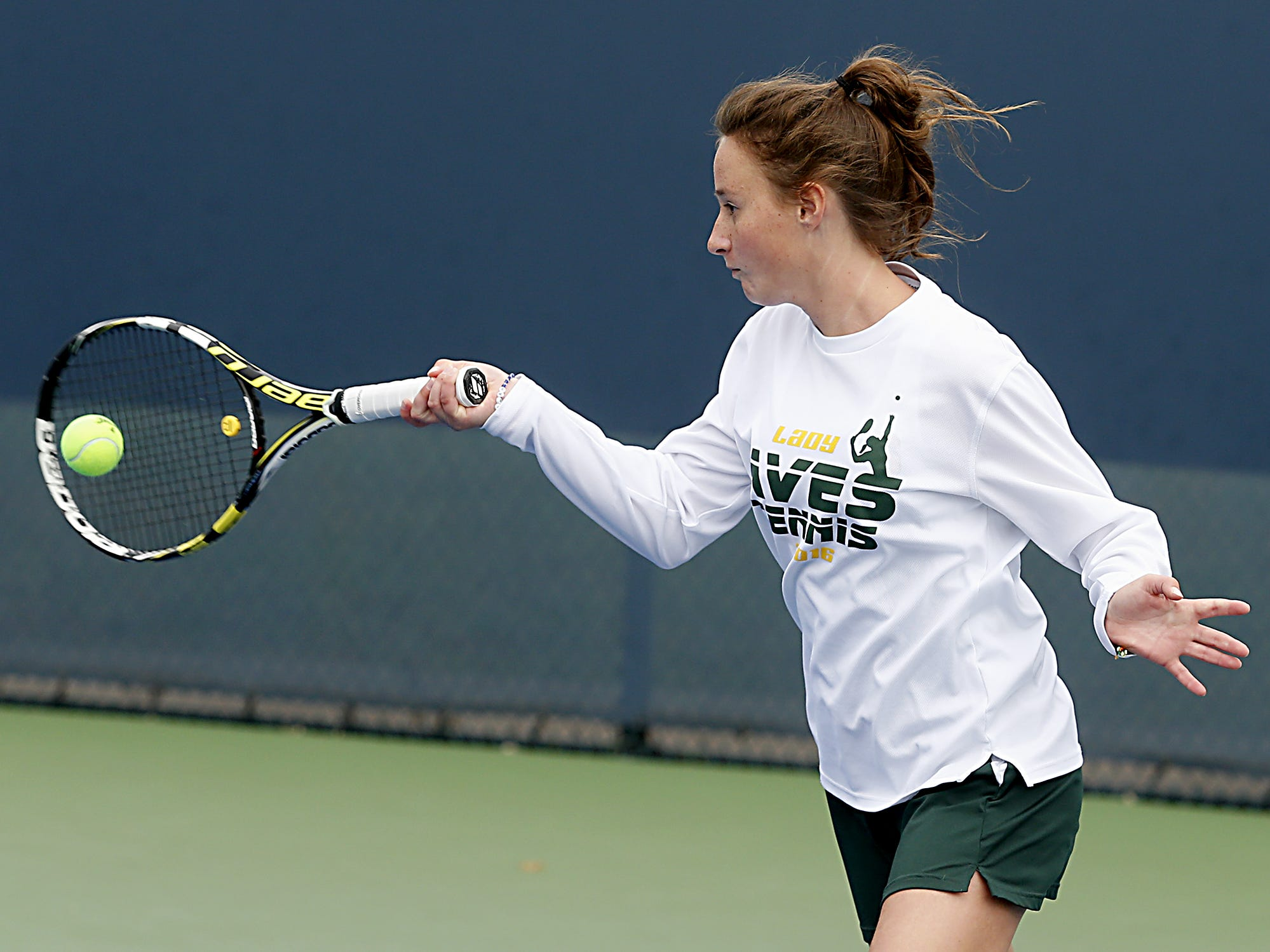 Sycamore's Sarah Wittenbaum returns a volley to Northmont during their girls district tennis tournament Division I doubles bracket at the Lindner Family Tennis Center in Mason Thursday, Oct. 11, 2018.