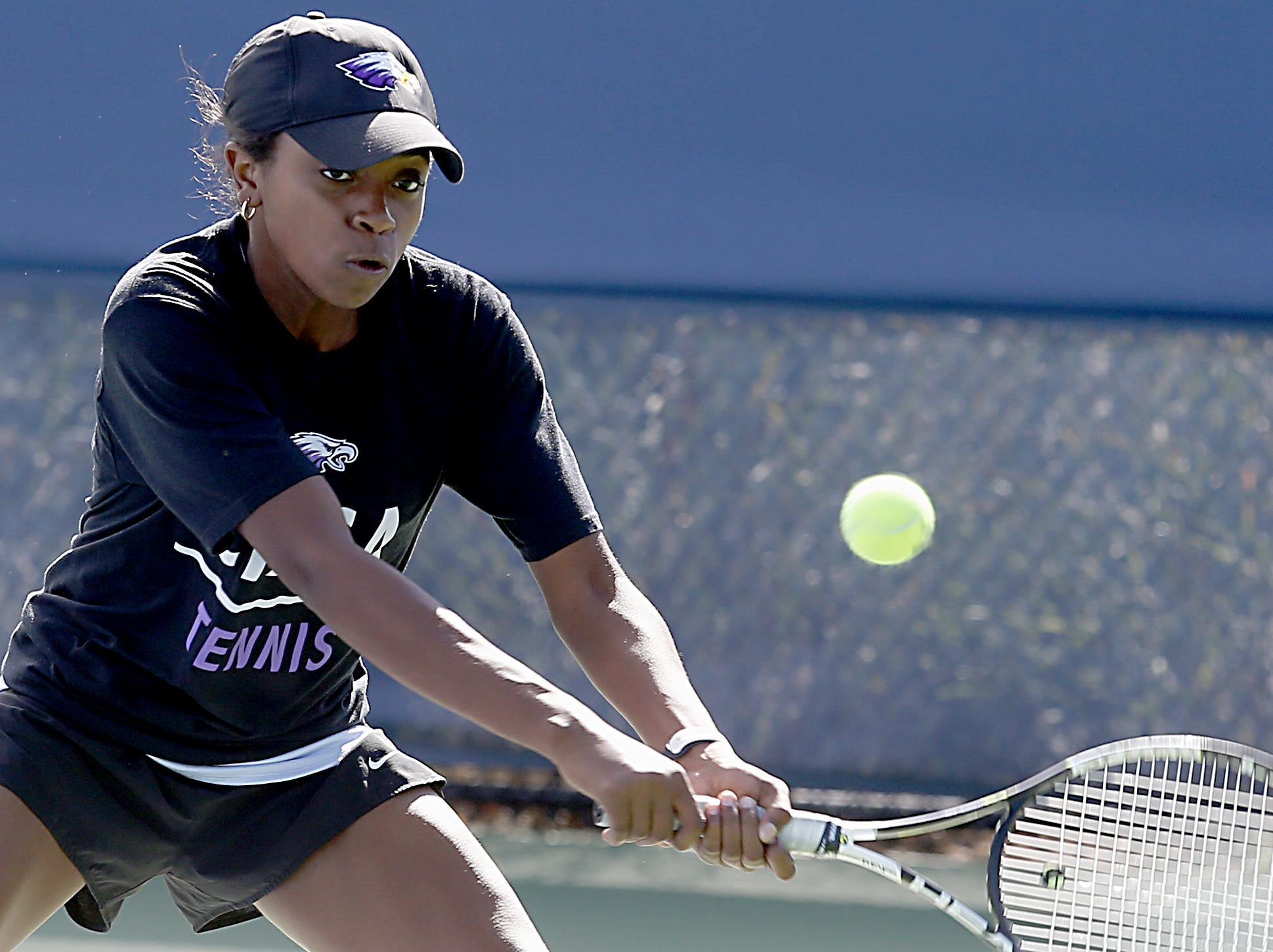 CHCA's Kennedy Puryear returns a shot to Wyoming during the girls district tennis tournament Division II doubles bracket at the Lindner Family Tennis Center in Mason Thursday, Oct. 11, 2018.