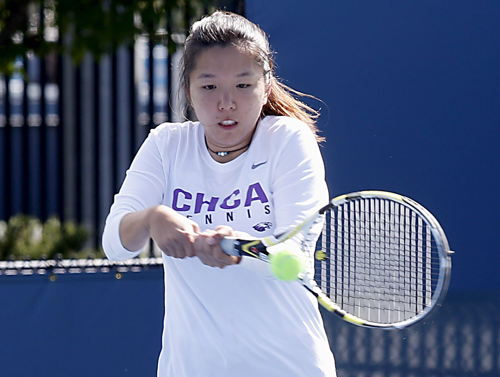 CHCA's Leanna Yuan returns a volley to Wyoming during the girls district tennis tournament Div II doubles bracket at the Lindner Family Tennis Center in Mason Thursday, Oct. 11, 2018.