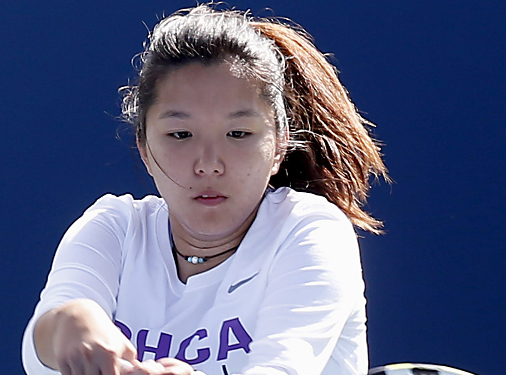 CHCA's Leanna Yuan returns a volley to Wyoming during the SWDAB girls district tennis tournament Div II doubles bracket at the Lindner Family Tennis Center in Mason Thursday, Oct. 11, 2018.
