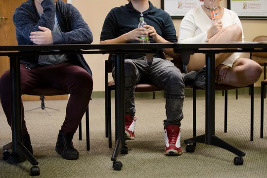 Teenagers take part in a Children's Home of Northern Kentucky outpatient substance-use disorder treatment session on Oct. 9 in Covington.