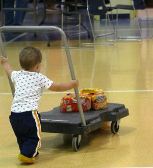 """This little guy helped bring the """"Stuff-a-Bus"""" food into the food pantry Oct. 6."""