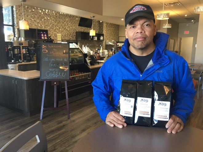 Ken Poindexter inside his second Clarksville location of Mugsy's Coffee Co.
