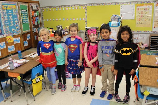 """Super Hero Day"" at Mt. Horeb: (Left to right) Klaudia Maziarz, Sasha Mehra, Isabella Santos, Emily Bash, Shail Hazari, Ela Patwa."