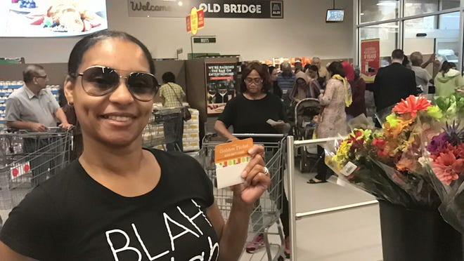 Tiffany Chavis of the Parlin section of Sayreville said she was excited to be one of 10 shoppers who received a Golden Ticket $100 gift card at the Oct. 10 grand opening of ALDI on Route 9 in Old Bridge. The first 100 shoppers each received a gift card valued at $10 to $100.