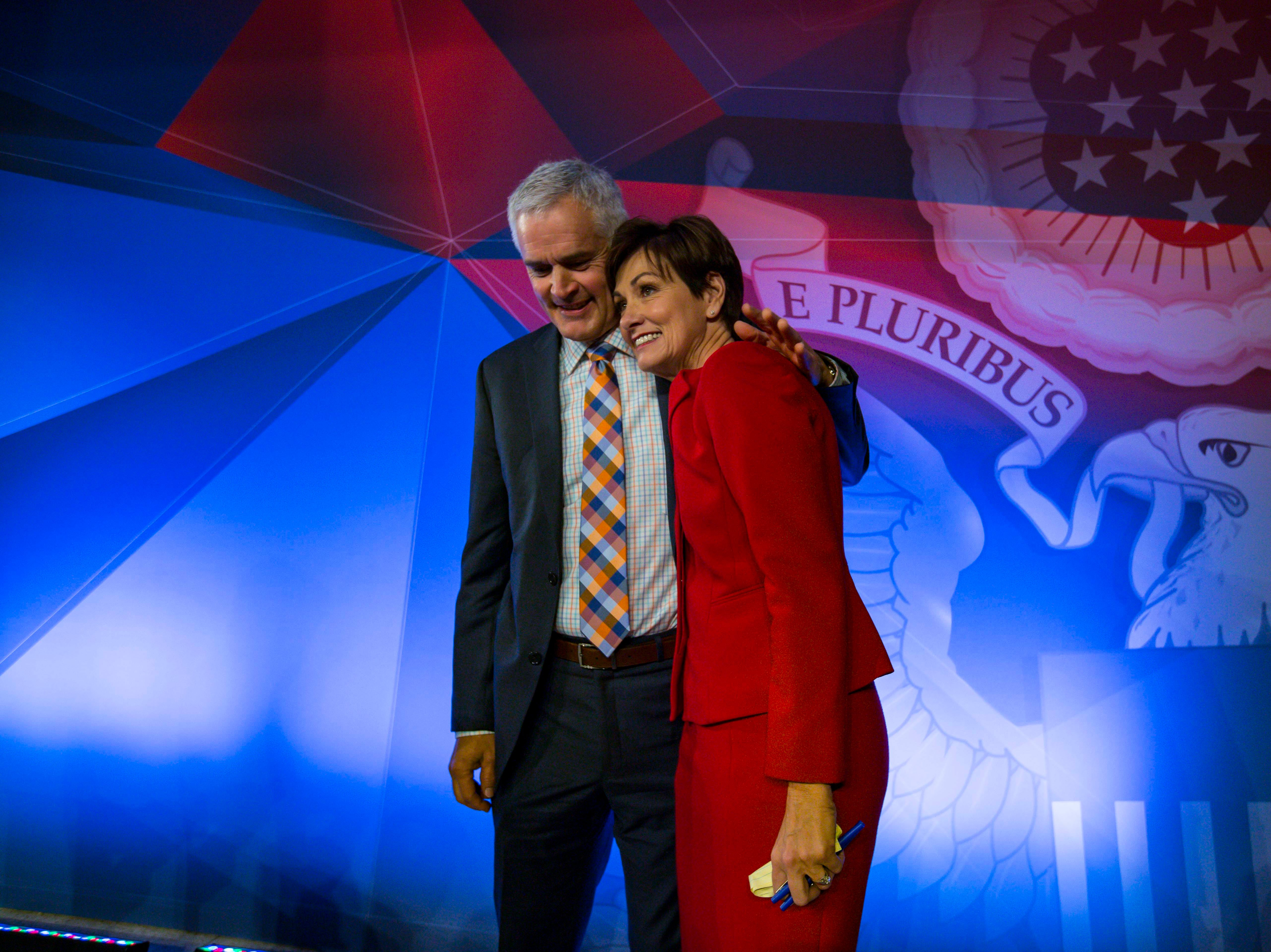 Republican Iowa Gov. Kim Reynolds hugs her husband Kevin after the debate Wednesday, Oct. 10, 2018, at Des Moines Area Community College in Ankeny, Iowa.