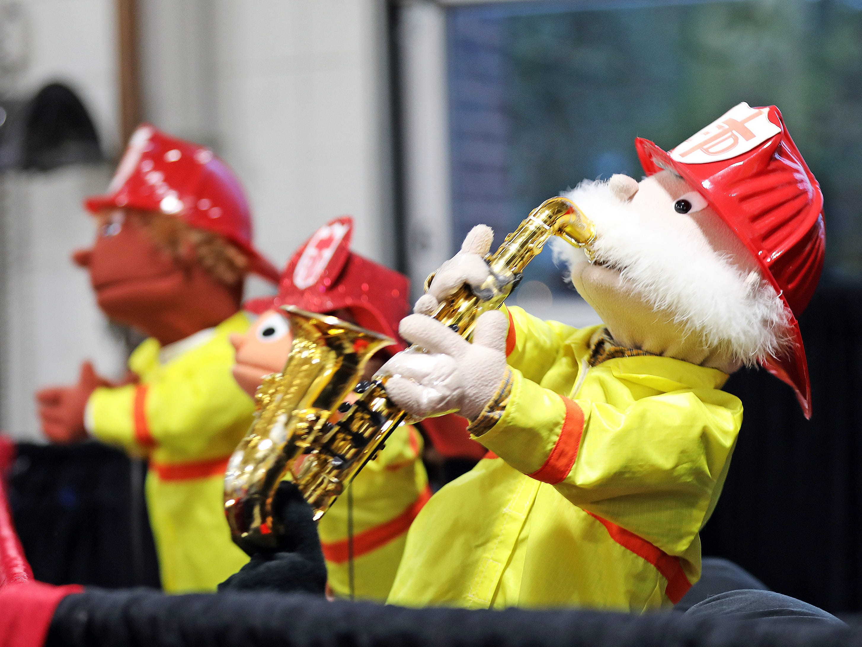 A puppet from Ankeny First United Methodist Church plays the sax as the group sings stop, drop, and roll during the Ankeny Fire Department's Fire Prevention Week Open House on Wednesday,  Oct. 10, 2018 at Fire Station #1, 120 N.W. Ash Dr. in Ankeny.