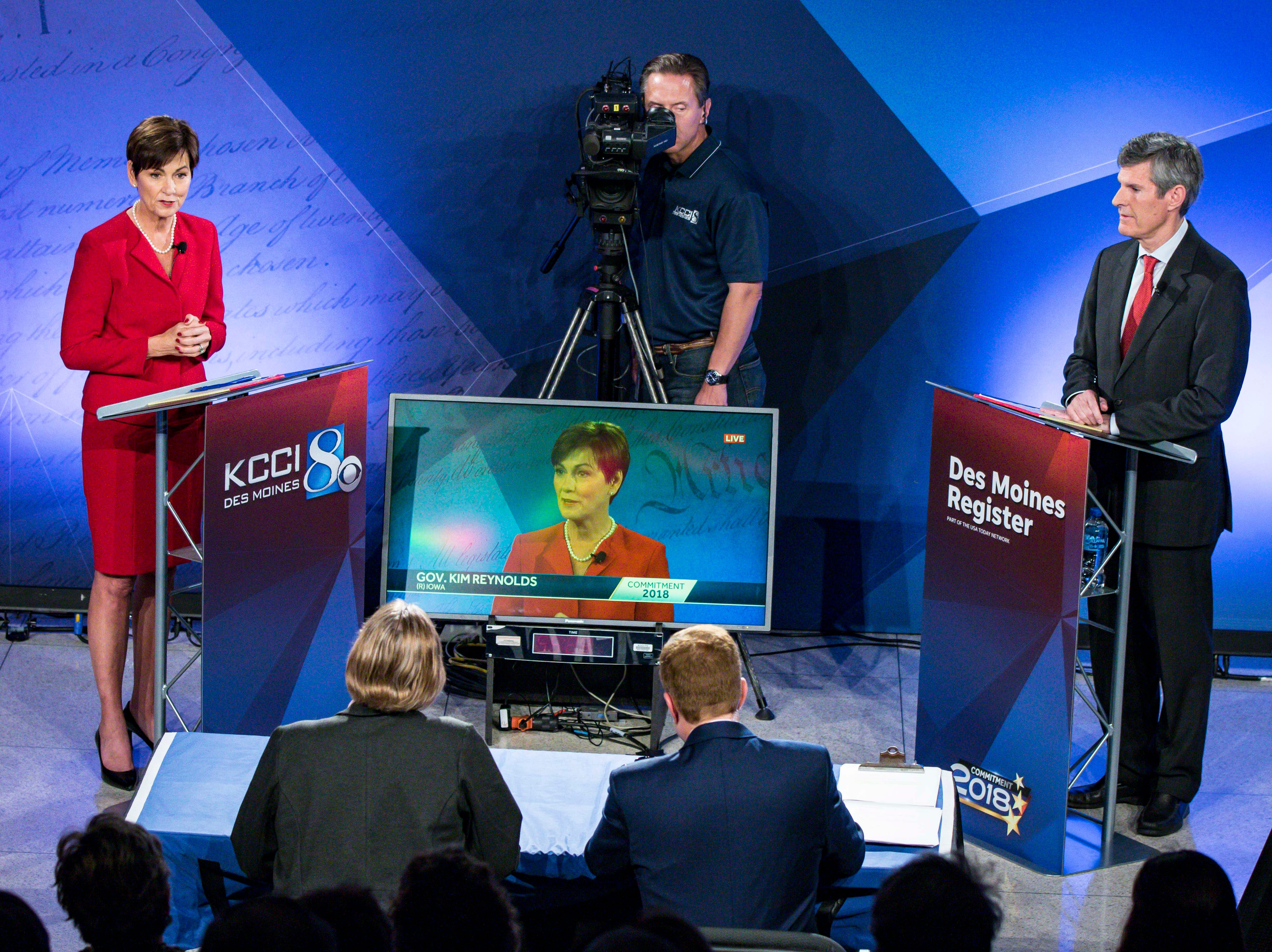 Republican Iowa Gov. Kim Reynolds and Democratic challenger Fred Hubbell face each other for the first time in a debate hosted by the Des Moines Register and KCCI Wednesday, Oct. 10, 2018, at Des Moines Area Community College in Ankeny, Iowa. The debate is moderated by the Register's Kathie Obradovich and KCCI's Steve Karlin.