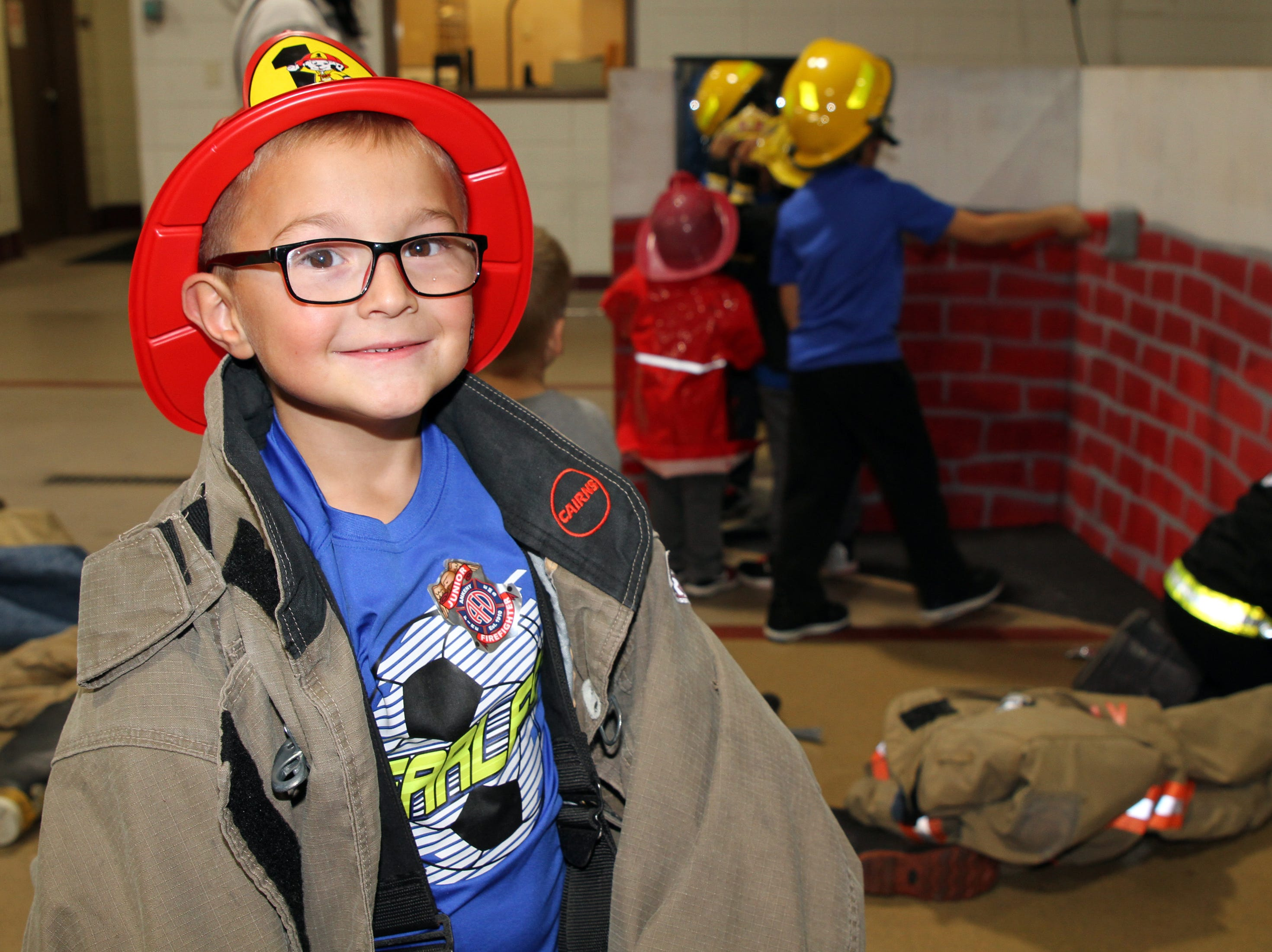 Keegan Whitmire, 6, of Ankeny tries on a fireman's jacket during the Ankeny Fire Department's Fire Prevention Week Open House on Wednesday, Oct. 10, 2018 at Fire Station #1, 120 N.W. Ash Dr. in Ankeny.