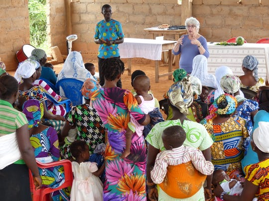 Mary Jane Oakland addresses a mothers' and infants' meeting in Beposo, Ghana, on Sept. 25.