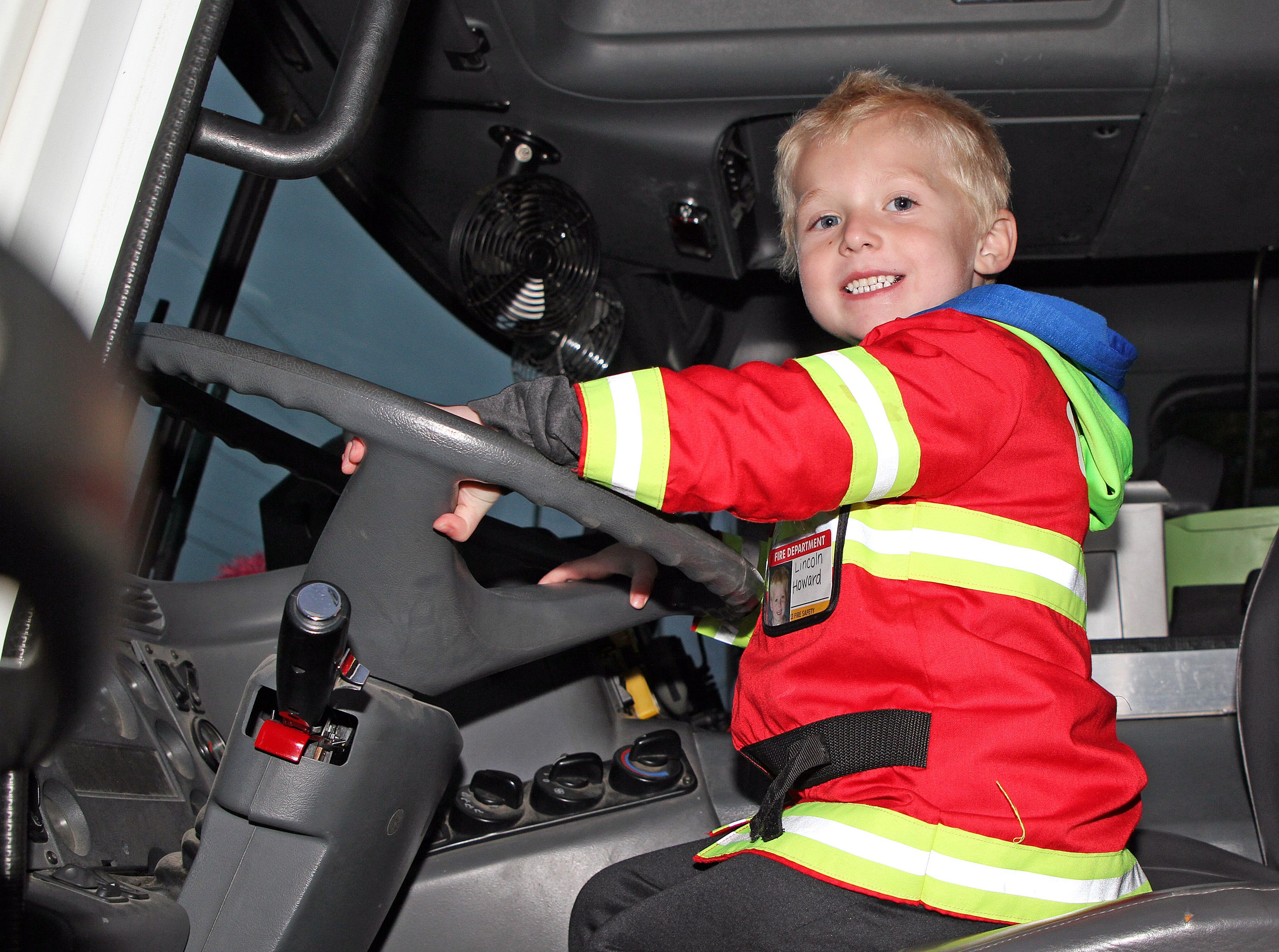Lincoln Howard, 5, of Ankeny checks out the fire truck  during the Ankeny Fire Department's Fire Prevention Week Open House on Wednesday,  Oct. 10, 2018 at Fire Station #1, 120 N.W. Ash Dr in Ankeny.