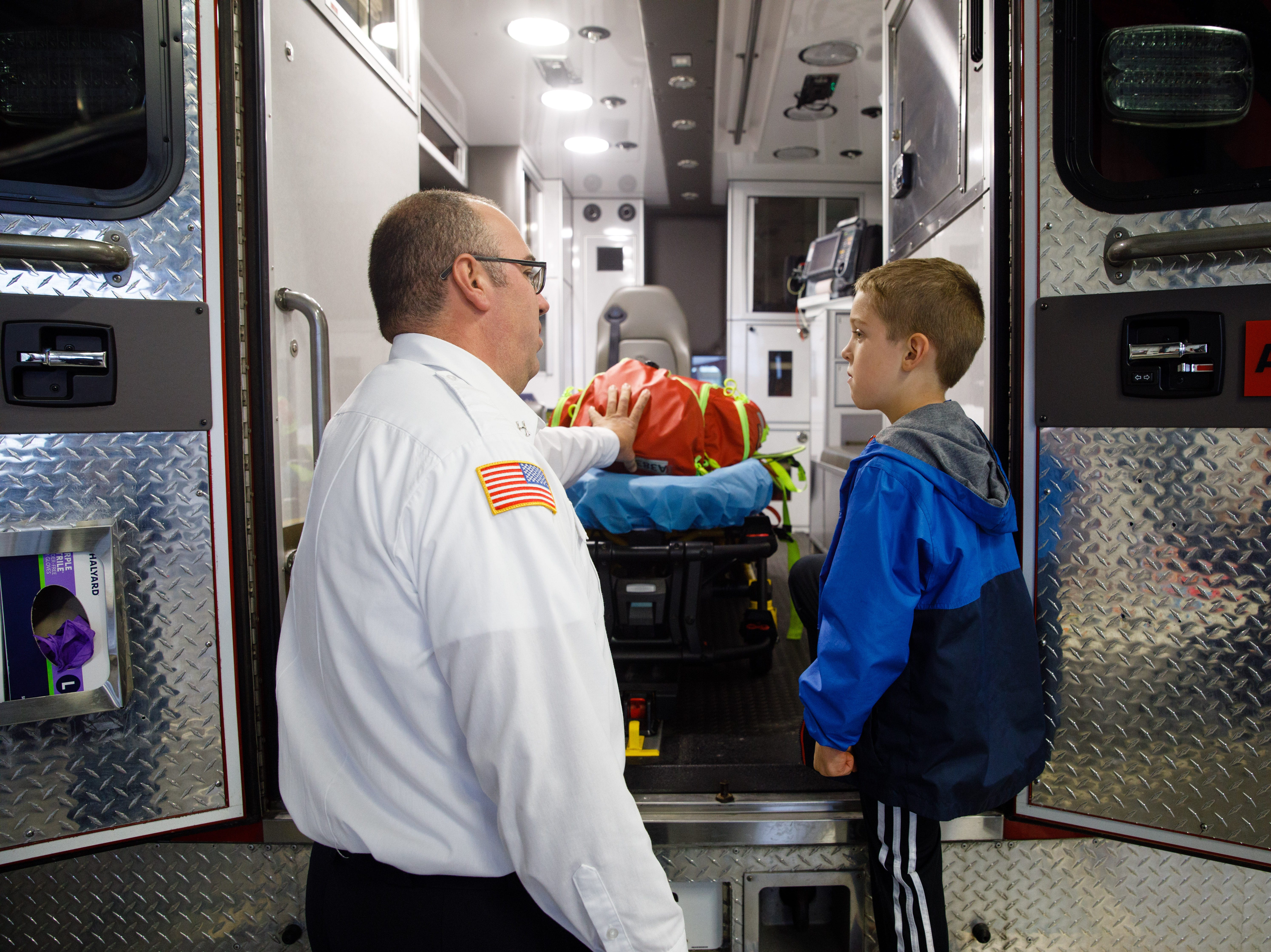 Fire Marshall Craig Van Huel shows the inside of an ambulance to Wyatt Puffer, 6, of Des Moines, Wednesday, Oct. 10, 2018, during the Johnston-Grimes Metropolitan Fire Department's annual Fire Prevention Week Open House at the 62nd Avenue Fire Station in Johnston.