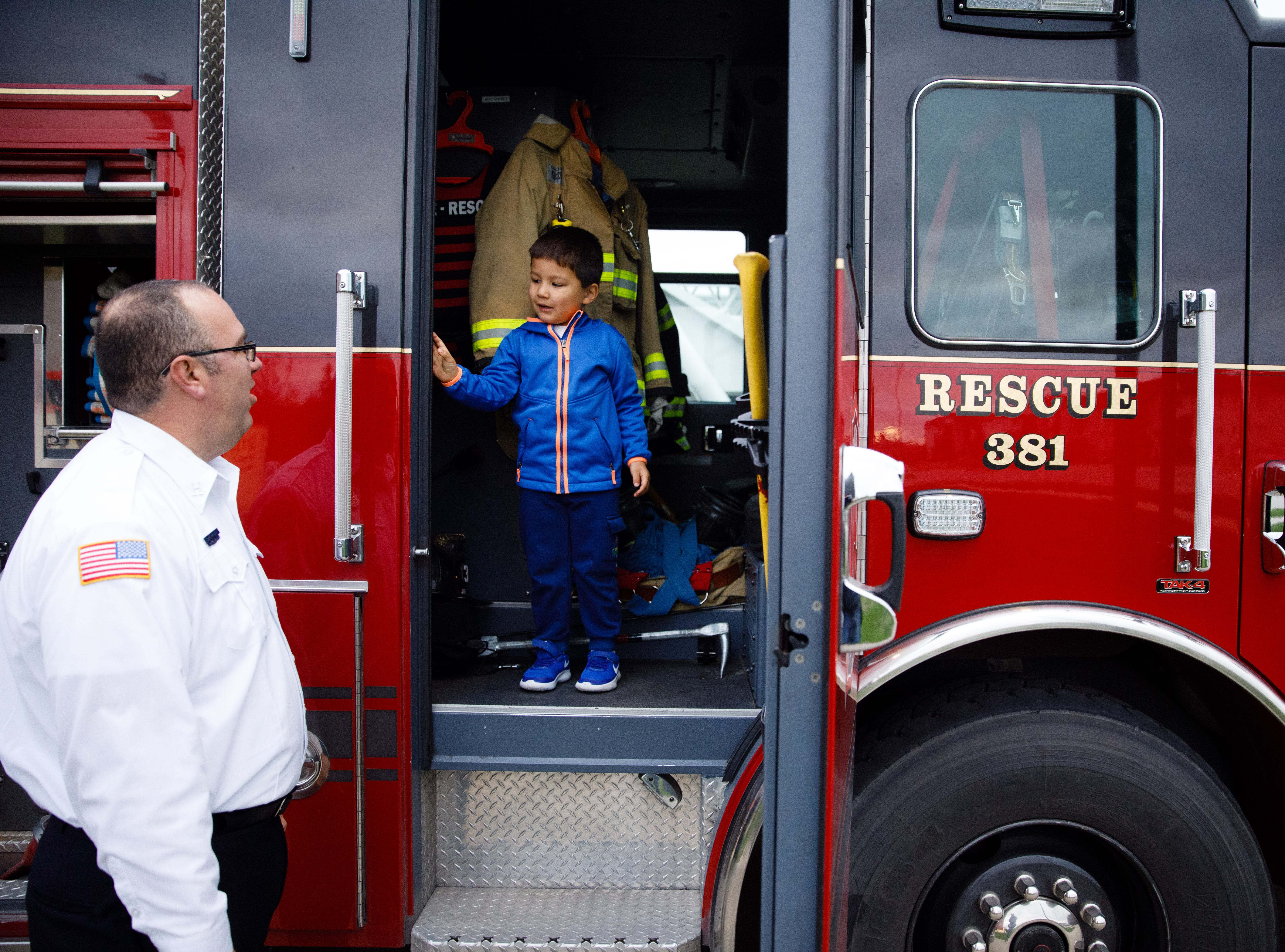 Grayson Pullen, 4, of Johnston checks out a fire truck while talking to Fire Marshall Craig Van Huel Wednesday, Oct. 10, 2018, during the Johnston-Grimes Metropolitan Fire Department's annual Fire Prevention Week Open House at the 62nd Avenue Fire Station in Johnston.