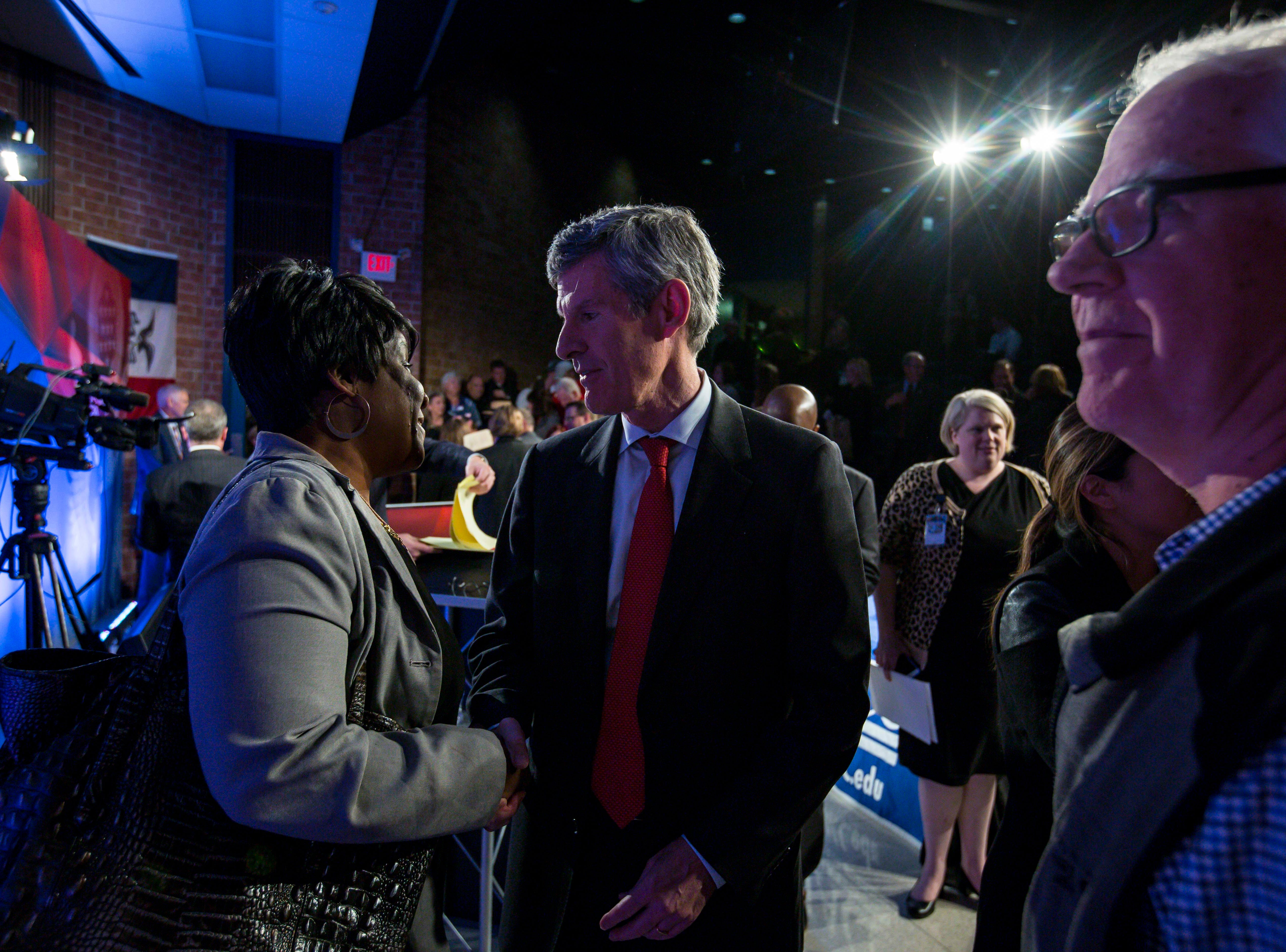 Democratic challenger Fred Hubbell talks to friends after the debate Wednesday, Oct. 10, 2018, at Des Moines Area Community College in Ankeny, Iowa.