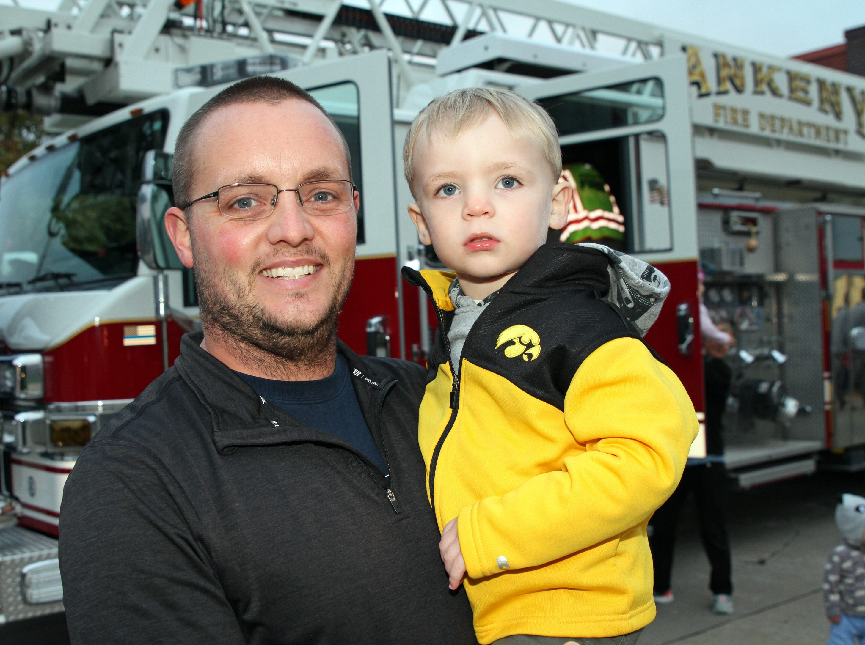 Scott and Callen Weinheimer, 2, of Ankeny enjoy the fire trucks on display during the Ankeny Fire Department's Fire Prevention Week Open House on Wednesday,  Oct. 10, 2018 at Fire Station #1, 120 N.W. Ash Dr in Ankeny.