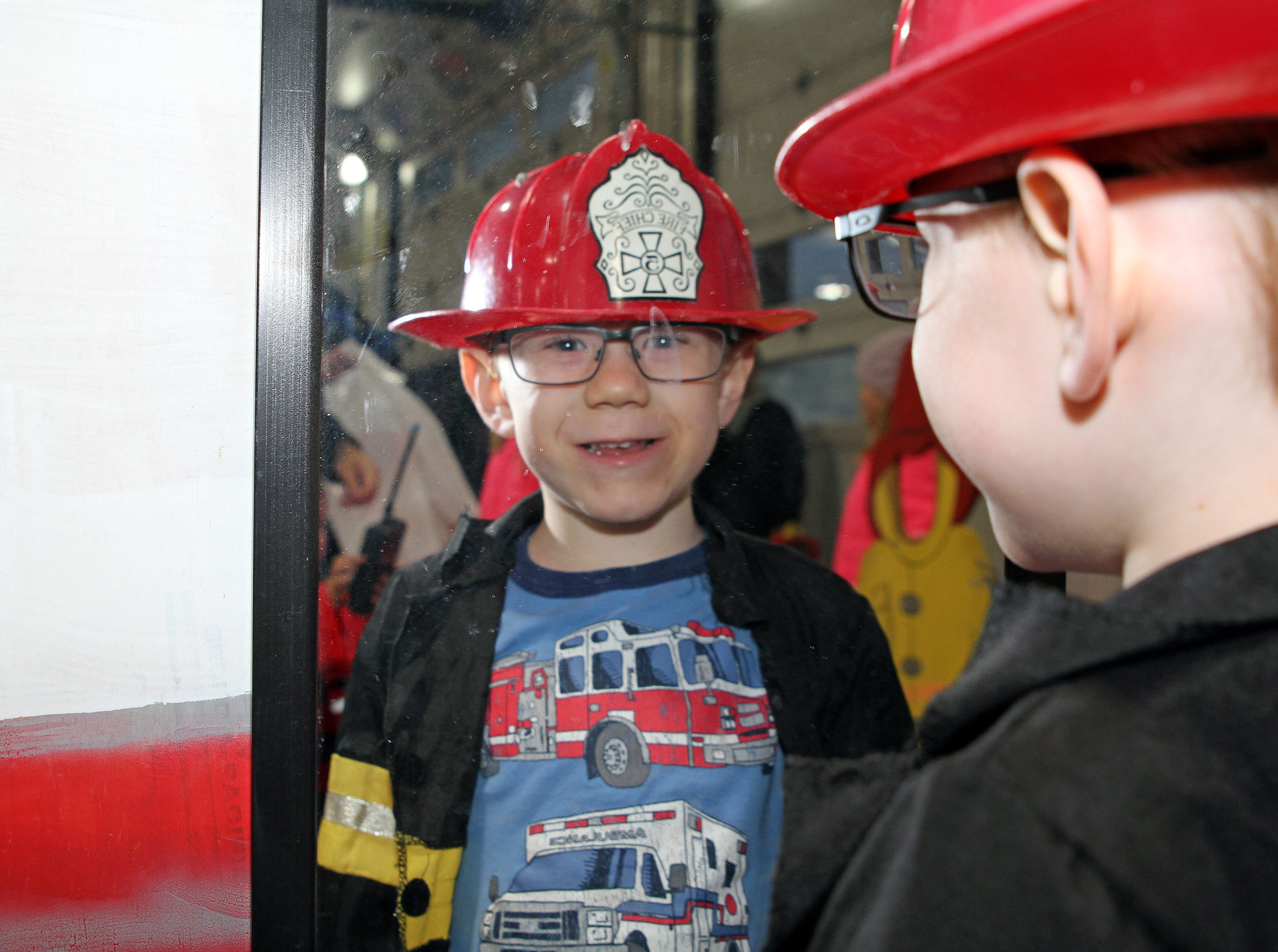 Hunter Radtke, 4, of Ankeny checks out his new outfit in the mirror during the Ankeny Fire Department's Fire Prevention Week Open House on Wednesday, Oct. 10, 2018 at Fire Station #1, 120 N.W. Ash Dr in Ankeny.