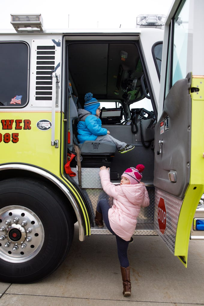 Sophie Lems, 4, and Braxton Lems, 3, both of Johnston, check out a ladder truck Wednesday, Oct. 10, 2018, during the Johnston-Grimes Metropolitan Fire Department's annual Fire Prevention Week Open House at the 62nd Avenue Fire Station in Johnston.