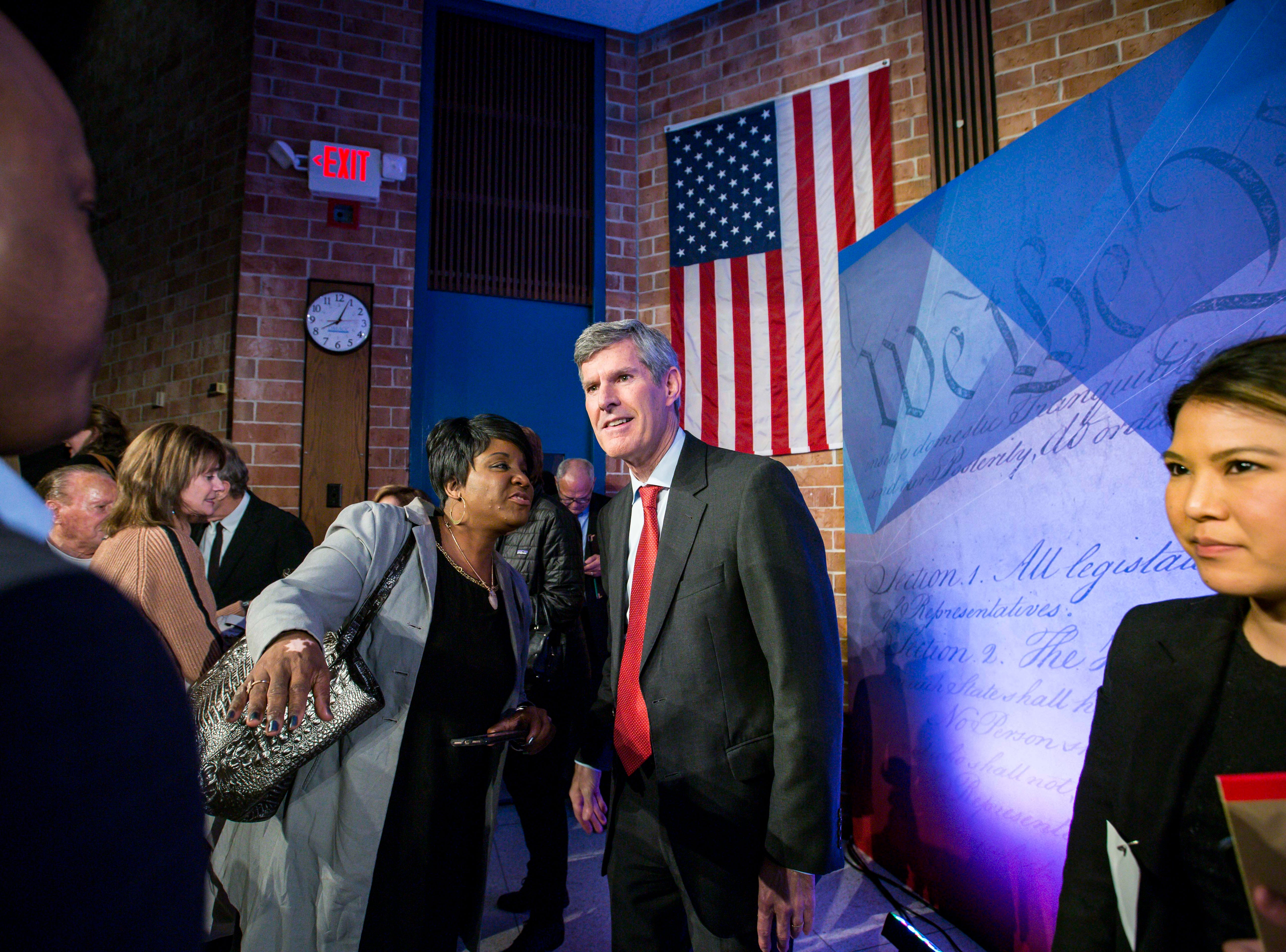 Democratic challenger Fred Hubbell greets family and friends after the debate Wednesday, Oct. 10, 2018, at Des Moines Area Community College in Ankeny, Iowa.
