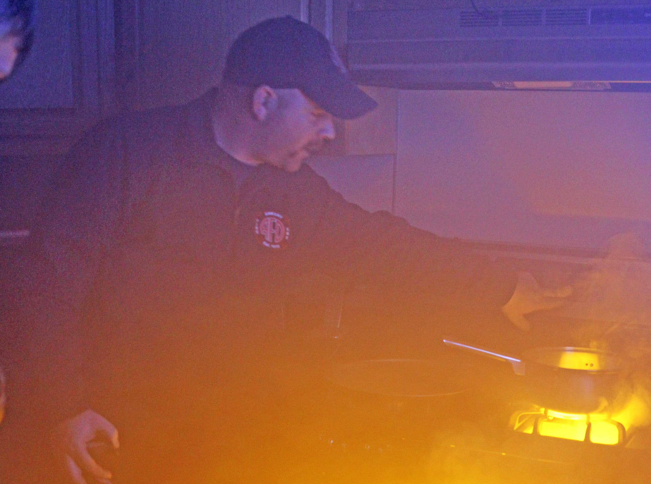 Zach Clear of the Ankeny Fire Dept. provides safety tips while cooking in the kitchen in the smoke house during the Ankeny Fire Department's Fire Prevention Week Open House on Wednesday, Oct. 10, 2018 at Fire Station #1, 120 N.W. Ash Dr. in Ankeny.