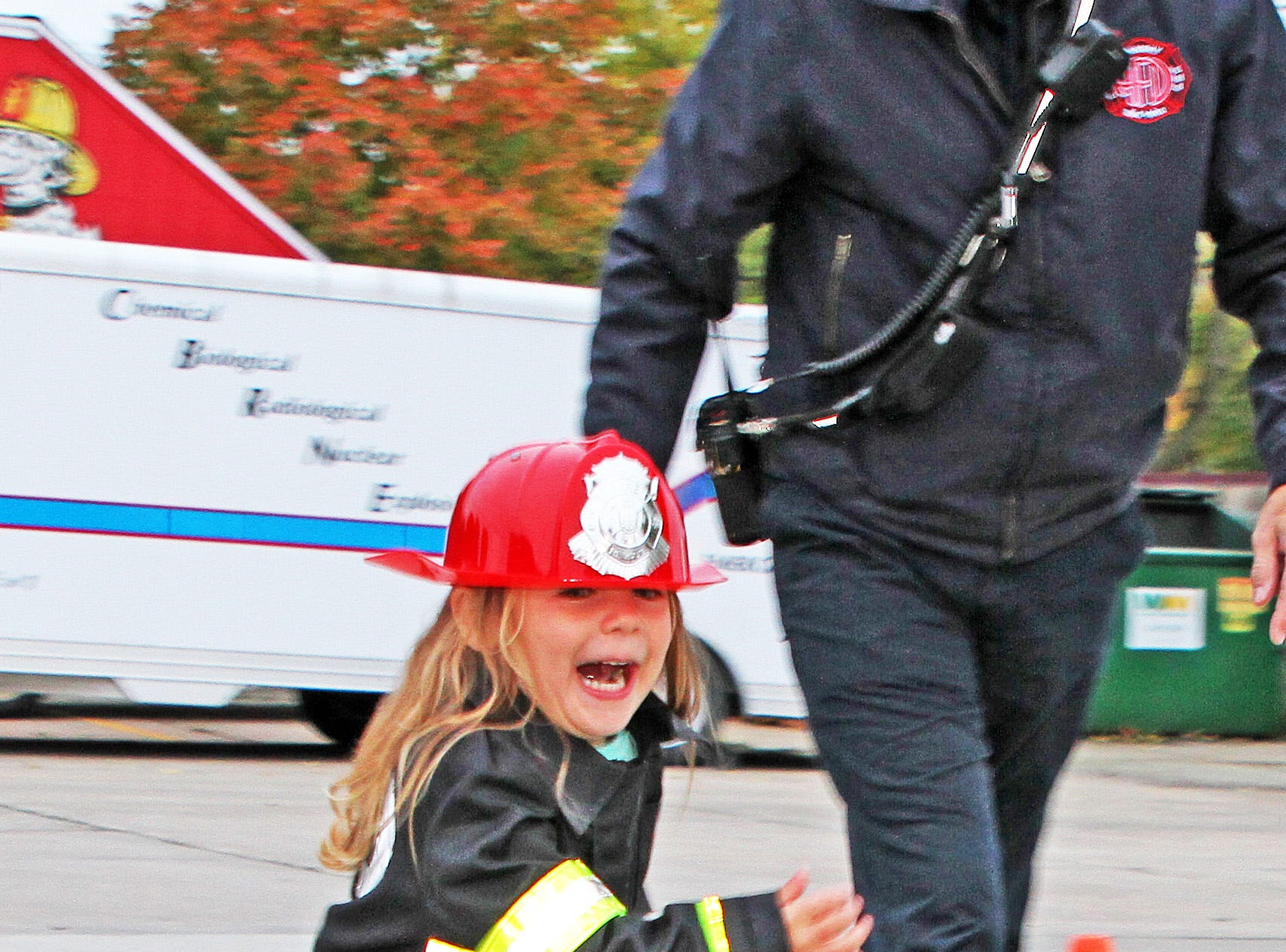 Adelyn Gervais, 3, of Ankeny sprints to the next stage of the Kids' Firefighter Challenge during the Ankeny Fire Department's Fire Prevention Week Open House on Wednesday,  Oct. 10, 2018 at Fire Station #1, 120 N.W. Ash Dr in Ankeny. The Open House includes a variety of educational, family-oriented hands-on activities for all ages. Residents can learn more about the power of fire prevention and technologies available to protect their own families from fire.