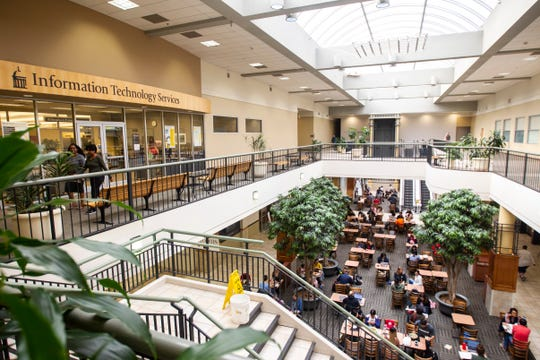 Students eat lunch in a foodcourt on Wednesday, Oct. 10, 2018, at the Old Capitol Town Center, in Iowa City.