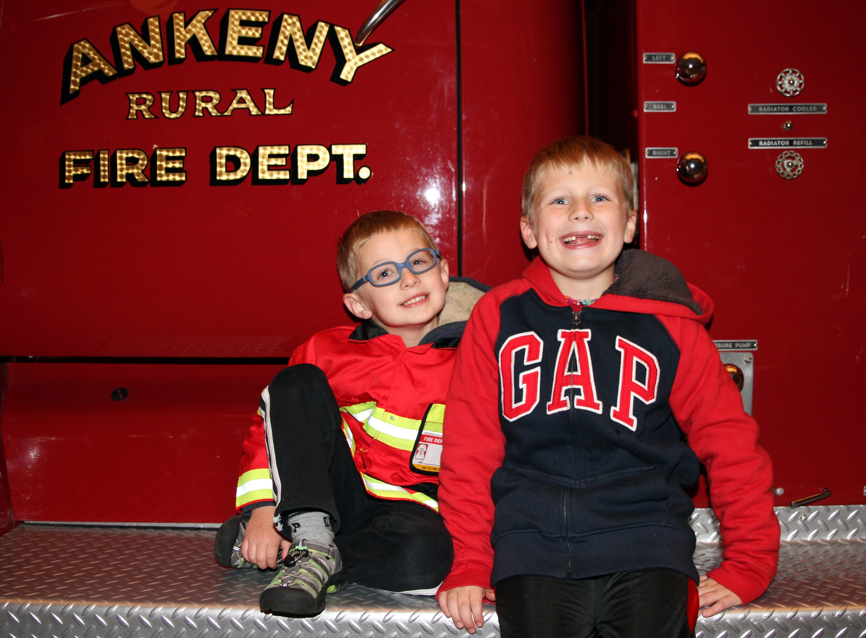 Brendan, 4, and Karter Meurer, 7, of Ankeny sit on the retired fire truck, Old 400, in the museum during the Ankeny Fire Department's Fire Prevention Week Open House on Wednesday, Oct. 10, 2018 at Fire Station #1, 120 N.W. Ash Dr. in Ankeny.