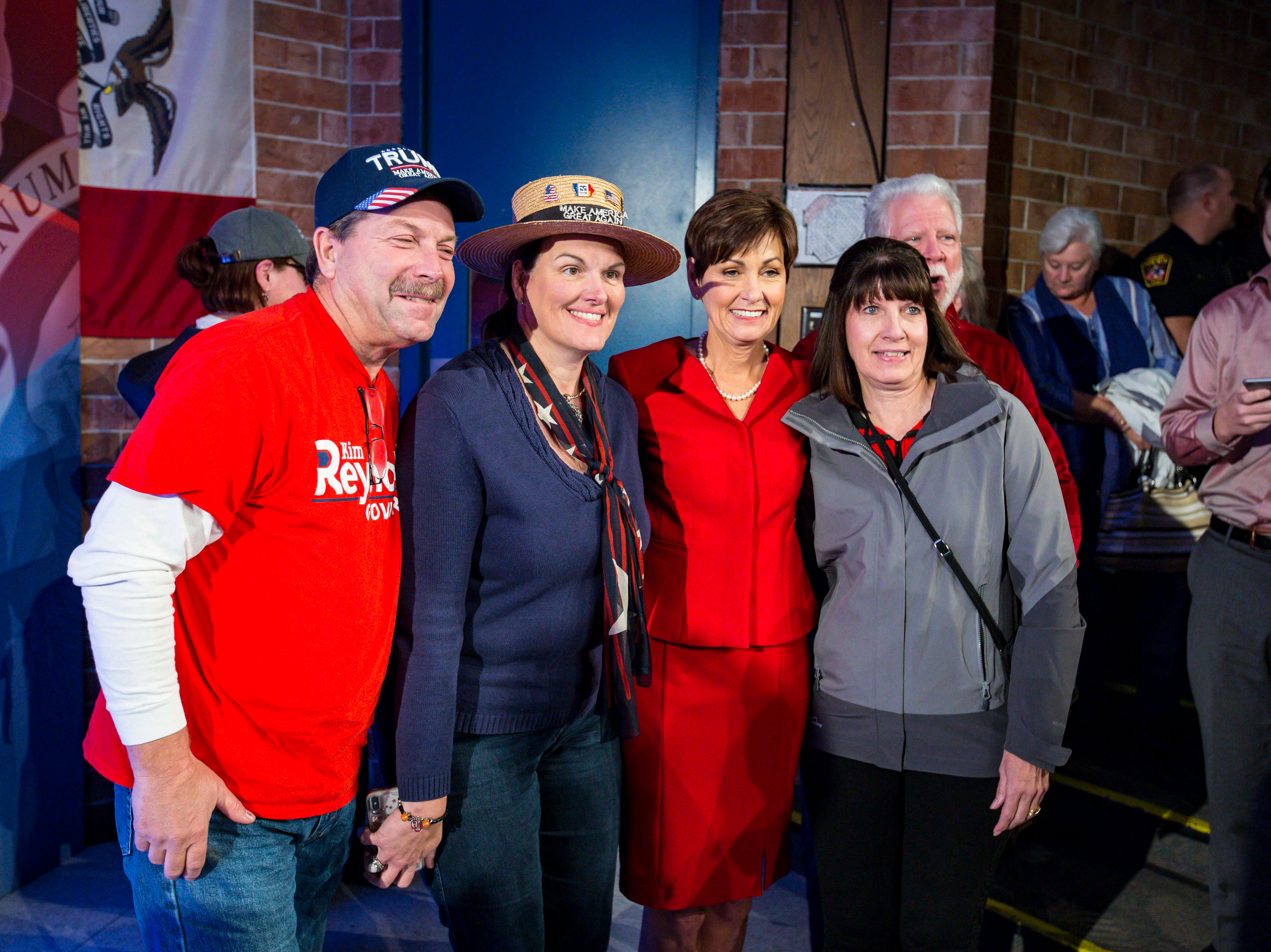 Republican Iowa Gov. Kim Reynolds takes pictures with family and friends after a debate hosted by the Des Moines Register and KCCI Wednesday, Oct. 10, 2018, at Des Moines Area Community College in Ankeny, Iowa.