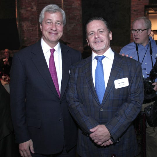 From left, Jamie Dimon,  JPMorgan Chase & Co. Chairman and CEO, stands with Dan Gilbert, founder of Quicken Loans, before JPMorgan Chase & Co.  unveils a $100 million, five-year commitment to support and accelerate Detroit's economic recovery in May 2014 in Detroit.