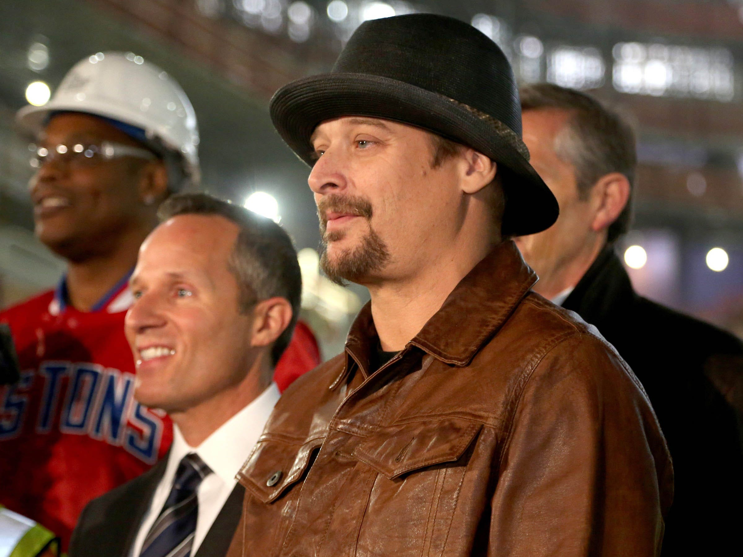 Kid Rock poses for a group picture with other dignitaries and construction workers after a press conference was held inside the Little Caesars Arena in Detroit in January 2017.
