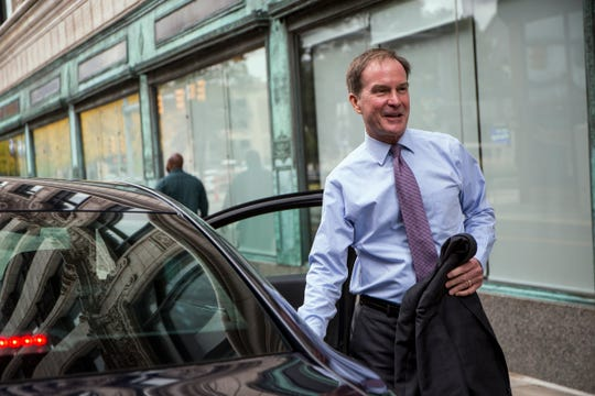 Michigan gubernatorial candidate Bill Schuette heads for his next appearance after taping a show at the Hockeytown Cafe, in Detroit, Mich., Tuesday, Oct 2, 2018.