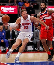 Detroit Pistons forward Blake Griffin (23), defended by Washington Wizards forward Markieff Morris (5), loses control of the ball during the first half of an NBA preseason basketball game Wednesday, Oct. 10, 2018, in Detroit. (AP Photo/Carlos Osorio)