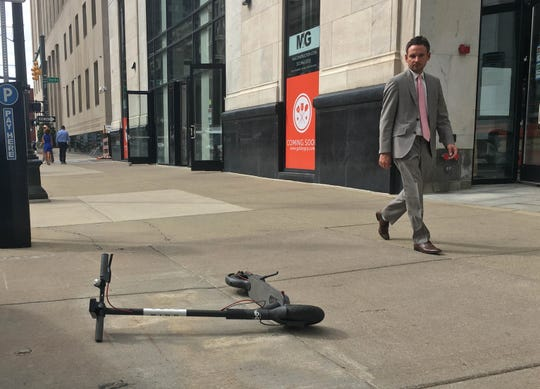 A Bird scooter on the sidewalk along Fort Street in downtown Detroit on Wed., Oct. 10, 2018.