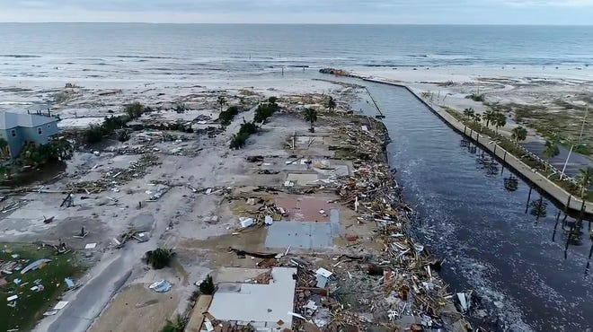 In this image made from video and provided by SevereStudios.com, damage from Hurricane Michael is seen in Mexico Beach, Fla. on Thursday, Oct. 11, 2018. Search-and-rescue teams fanned out across the Florida Panhandle to reach trapped people in Michael's wake Thursday as daylight yielded scenes of rows upon rows of houses smashed to pieces by the third-most powerful hurricane on record to hit the continental U.S.