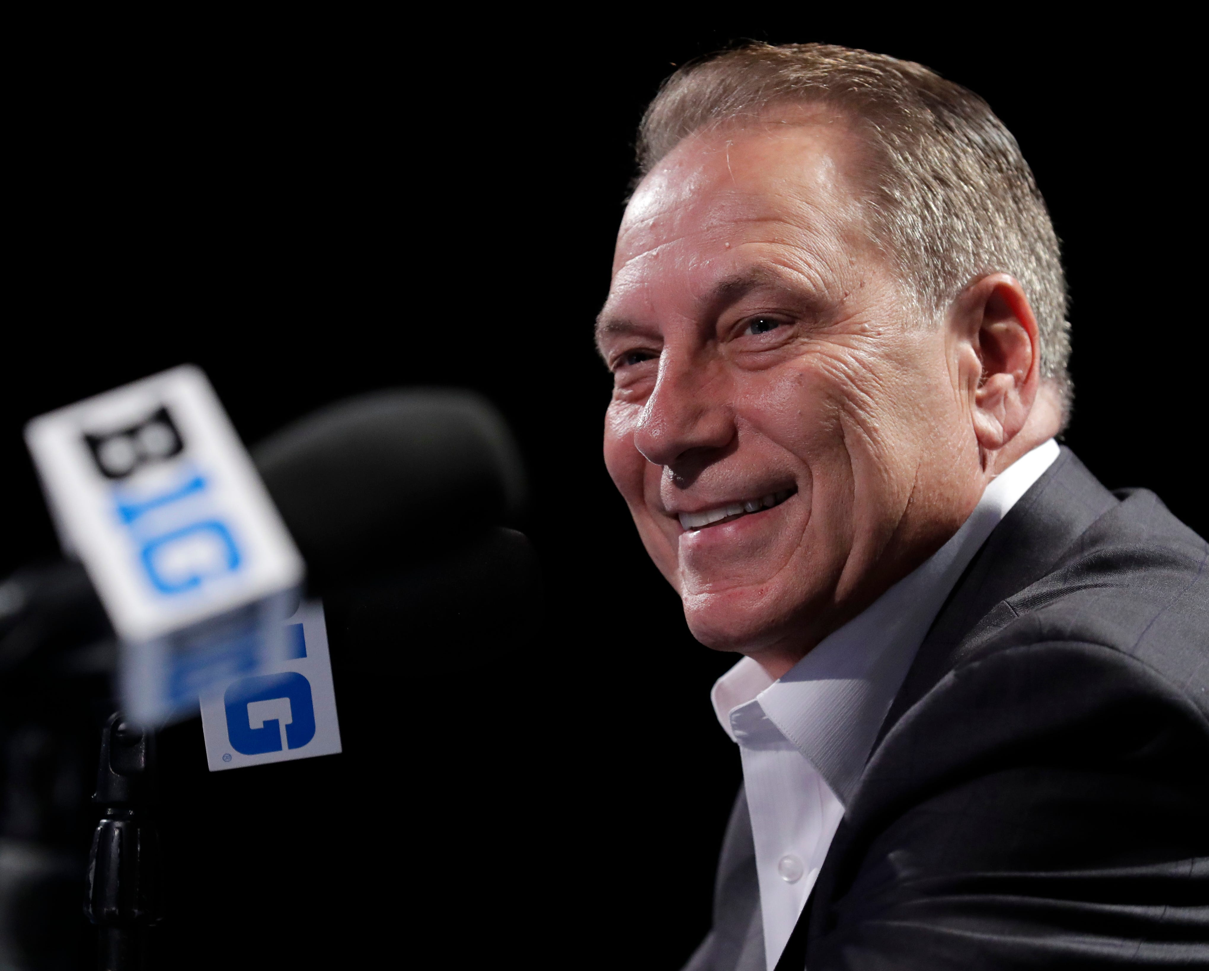 Michigan State coach Tom Izzo smiles as he speaks at a news conference during Big Ten basketball media day on Thursday, Oct. 11, 2018, in Rosemont, Ill.
