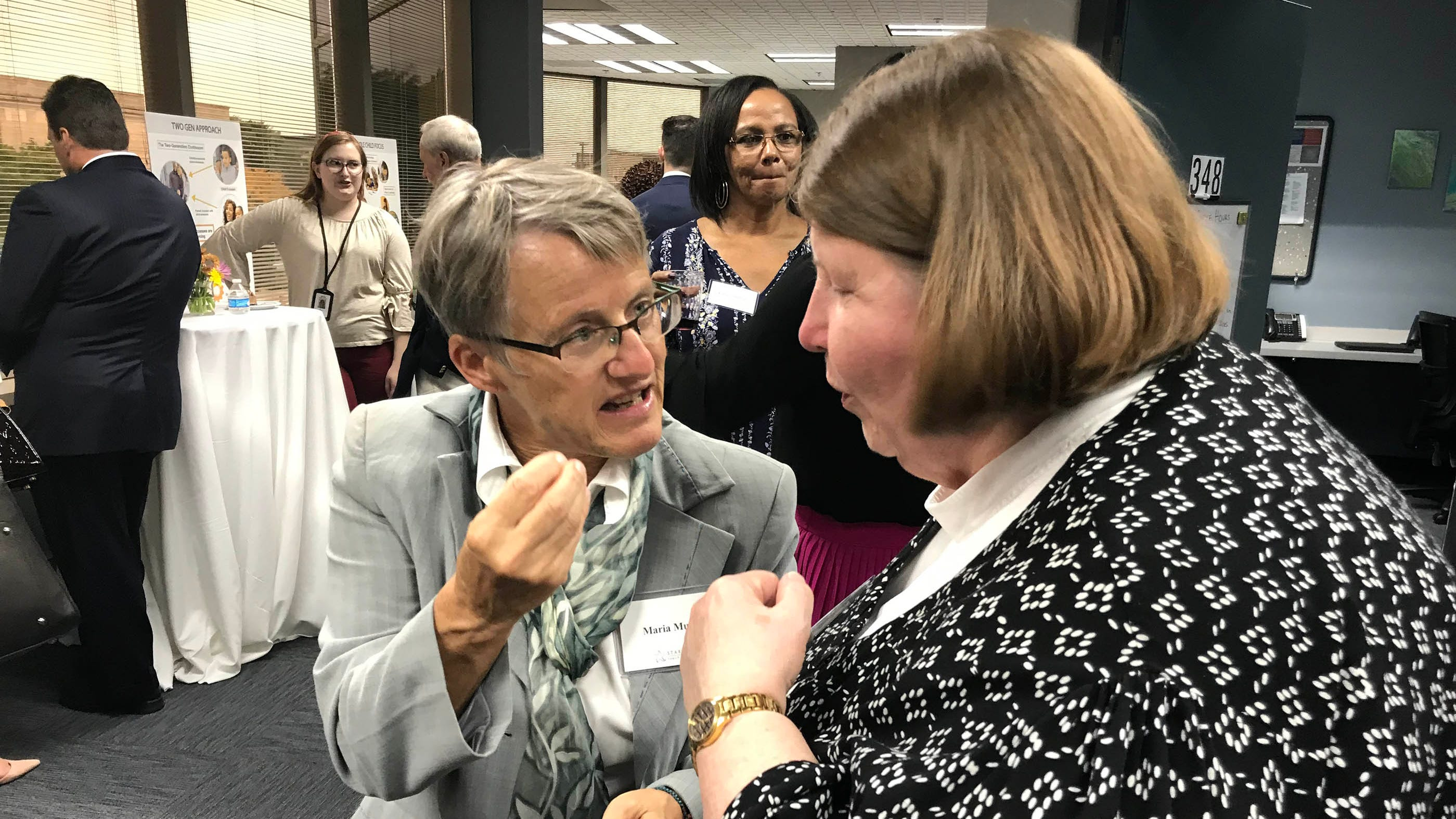 Dr. Maria Muzik, an Associate Professor in the University of Michigan's Department of Psychiatry, left, chats with Mary Ludtke from the Michigan Department of Health and Human Services Wednesday, Oct. 10, 2018 at the opening of the new Starfish Partnering with Parents Center in Dearborn.