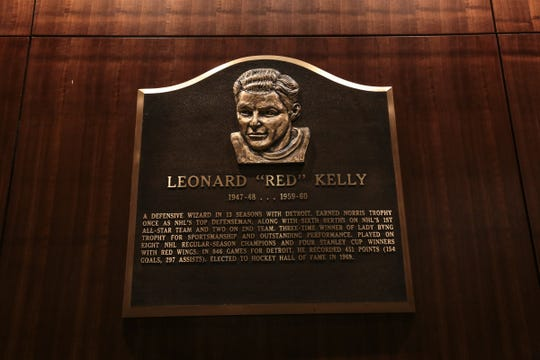 "A plaque of former Detroit Red Wings player Leonard ""Red"" Kelly is seen hanging in a hallway off of the players lounge area during a media tour of the Little Caesars Arena in downtown Detroit on Wednesday, Sept. 6, 2017."