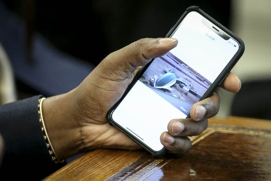 Rapper Kanye West holds his phone with a picture of a plane after he showed it to President Donald Trump during a meeting at the White House on October 11, 2018 in Washington, DC.