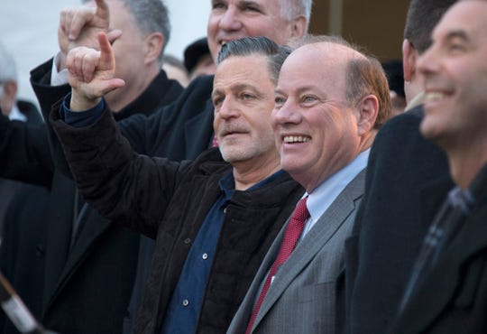 Dan Gilbert, Bedrock founder, left, and Detroit Mayor Mike Duggan at the ground breaking for the skyscraper that will be built on the site of the former Hudson's store in downtown Detroit in December 2017.