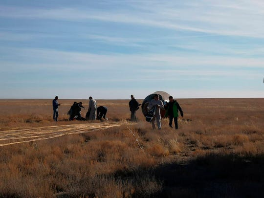 The Soyuz MS-10 space capsule lays in a field after an emergency landing near Dzhezkazgan, about 450 kilometers (280 miles) northeast of Baikonur, Kazakhstan.