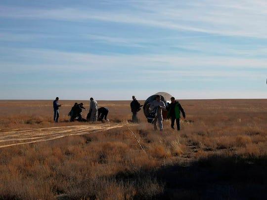 The Soyuz MS-10 space capsule lays in a field after an emergency landing near Dzhezkazgan, about 450 kilometers (280 miles) northeast of Baikonur, Kazakhstan.