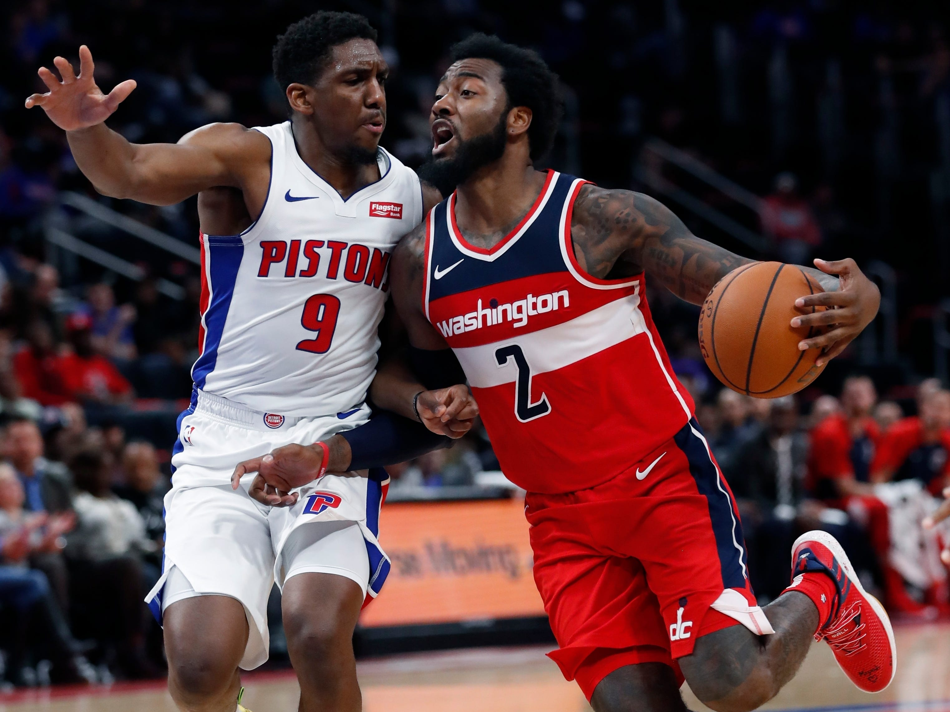 Washington Wizards guard John Wall (2) drives on Detroit Pistons guard Langston Galloway (9) during the second half.
